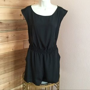 Black BCBG romper with slit cape back